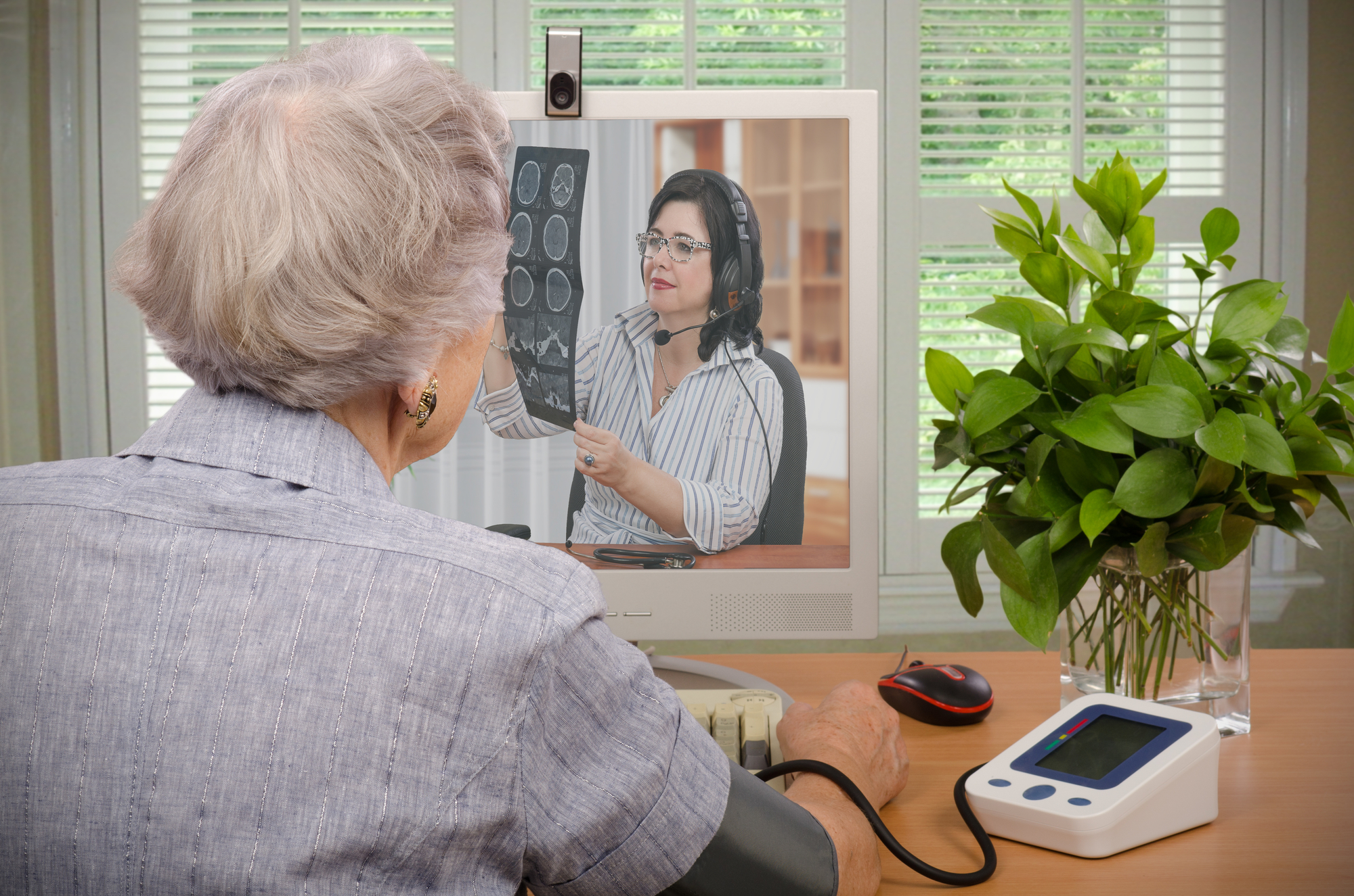 senior woman and doctor having teledentistry visit