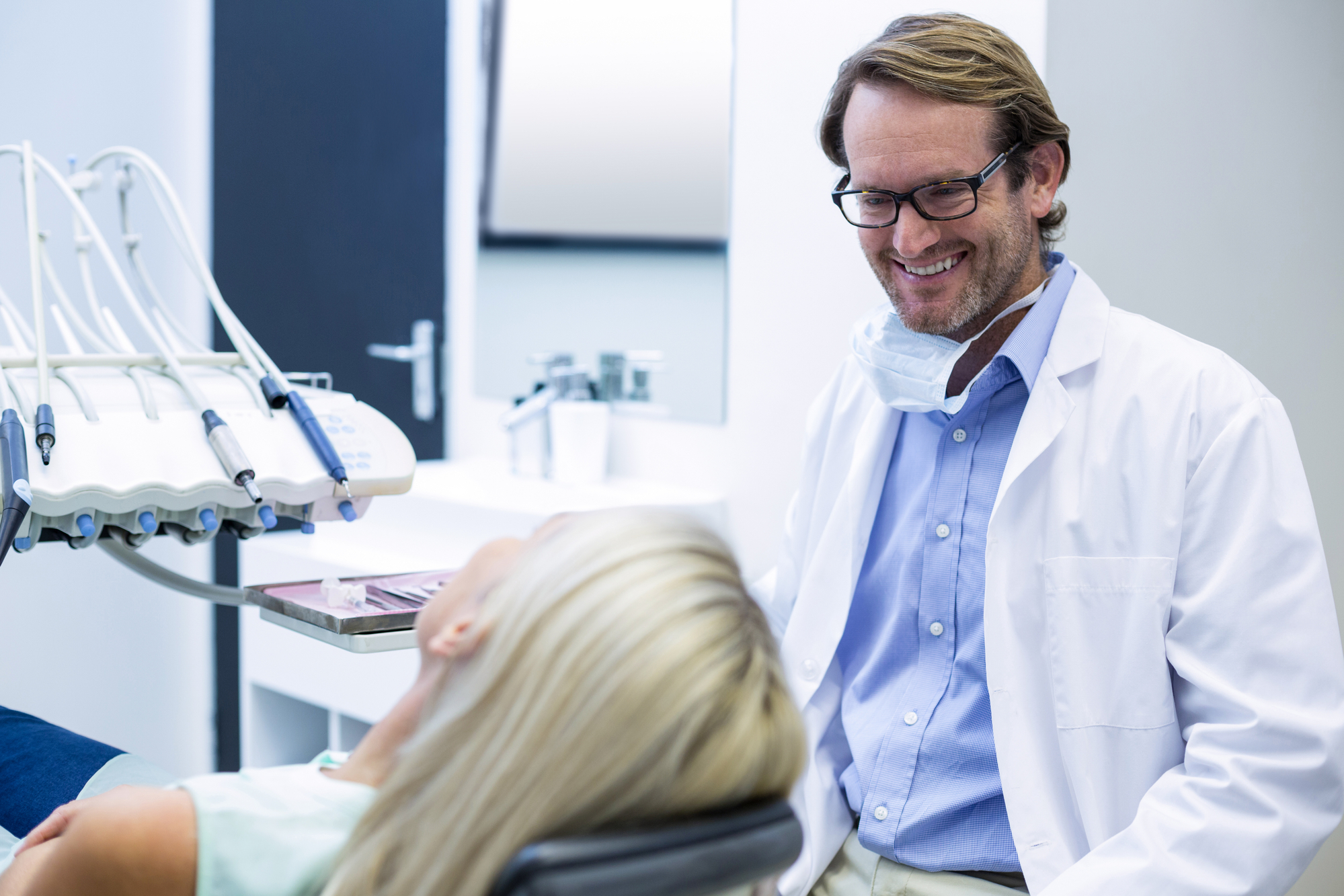 dentist discussing treatment with patient