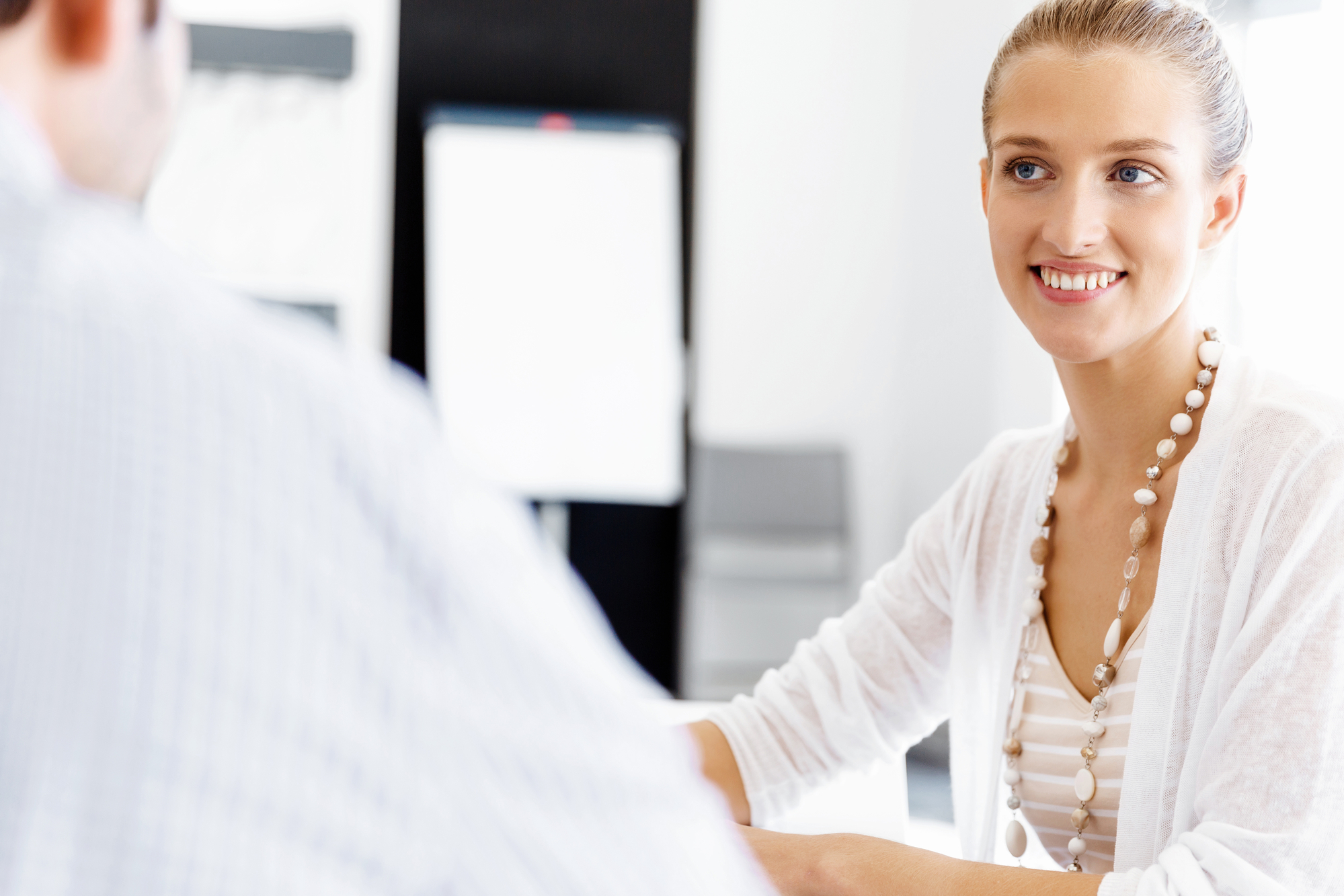 Female office manager greeting male patient